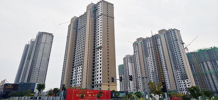 星港城8号楼今日喜迎封顶 一期即将实景呈现!